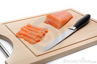 Fresh raw salmon fish on wooden board isolated