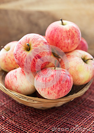 Fresh red apples in basket