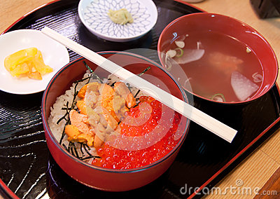 Fresh red caviar with rice