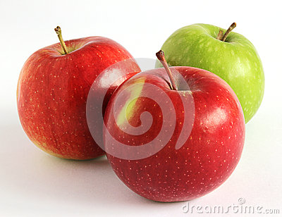 Fresh red and green apples on a white background
