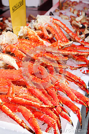 Fresh red king-crab legs in ice at seafood market