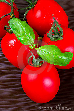 Fresh red tomatoes with basil