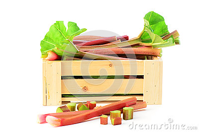 Fresh rhubarb in wooden crate