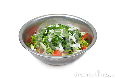 Fresh salad in metal bowl  on white