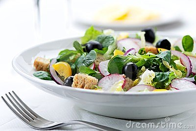 Fresh salad with olives, prawns, lemons and sauce