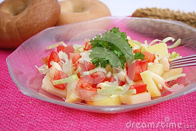 A fresh salad of potatoes and tomatoes