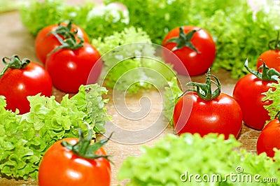 Fresh salad and a  tomato