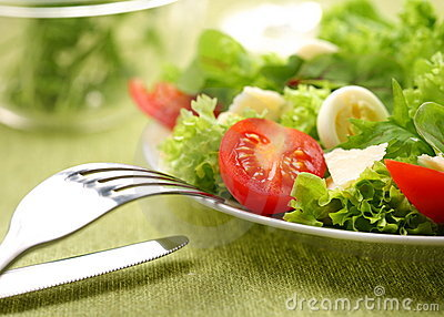 Fresh salad with tomato and quail eggs