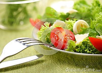 Fresh salad with tomato and quail eggs