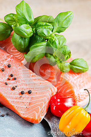 Fresh salmon fillet with basil