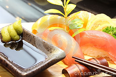 Fresh salmon tuna sushi set with chopsticks wasabi
