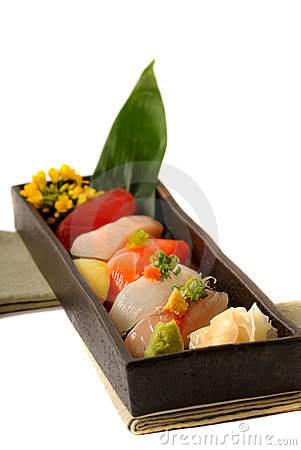 Fresh seafood sushi nigiri with lemon and flowers