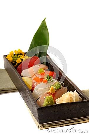 Fresh seafood sushi nigiri with lemon and flowers