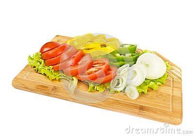 Fresh sliced vegetables on white