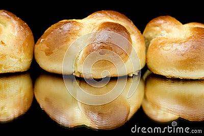 Fresh small loaf on black closeup