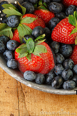Fresh Strawberries and Blueberries in Colander