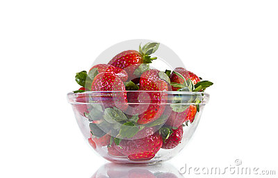 Fresh strawberries in glassy bowl