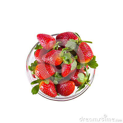 Fresh strawberries in glassy clear bowl