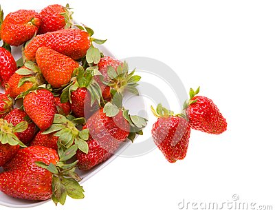 Fresh strawberries on a platter isolated on white