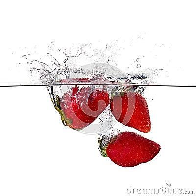 Fresh Strawberries Splash in Water Isolated on White Background