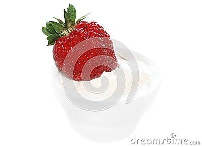 Fresh strawberry in cream isolated