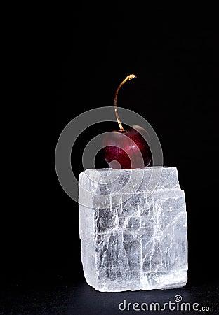 Fresh sweet cherry on black