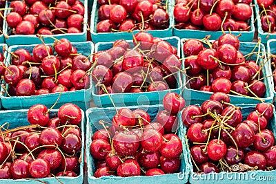 Fresh sweet red cherries in boxes