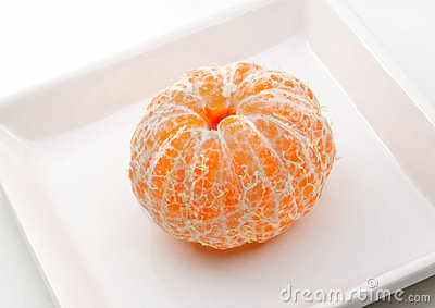 Fresh tangerine on a plate.