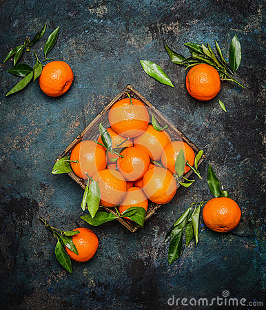 Free Fresh Tangerines With Leaves On Dark Grunge Background Stock Image - 64480611