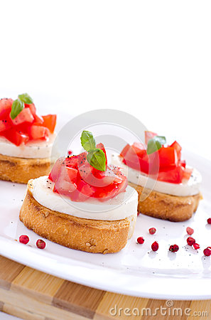 Fresh tasty bruschetta with mozzarella