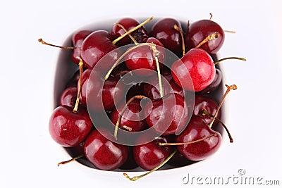 Fresh tasty cherries  on bowl