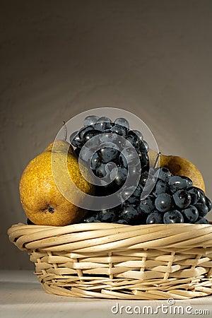 Fresh tasty fruit in the bast basket