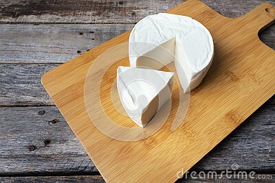 Fresh and tasty mexican panela cheese on wood background. Fresh and tasty mexican panela cheese board on wood background royalty free stock photos