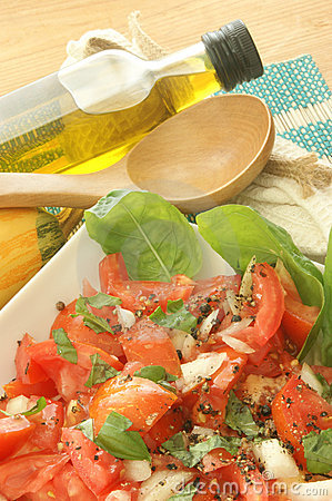 Fresh tomato salad with basil and onion