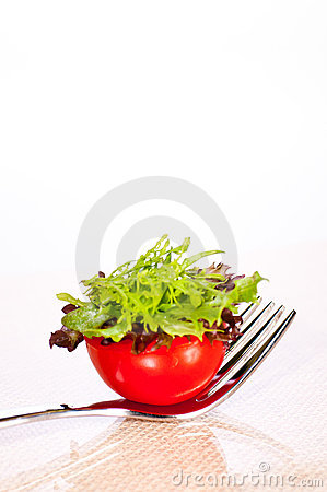 Fresh tomato and salad canape on a fork royalty free stock for Canape forks