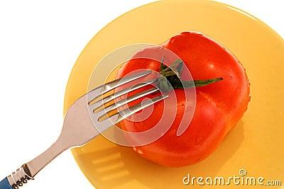 Fresh tomatoe and fork