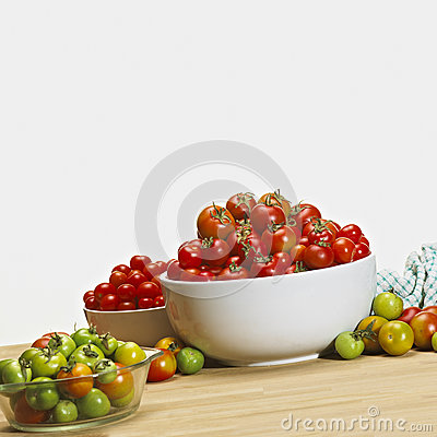 Fresh tomatoes in bowls