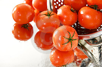 Fresh tomatoes on the mirror with strainer