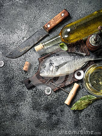 Free Fresh Unprepared Dorado Fish With White Wine. Stock Image - 109109921