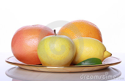Fresh useful fruits on mirror table