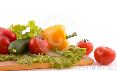Fresh vegetables on board on white background