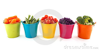 Fresh vegetables in colorful buckets