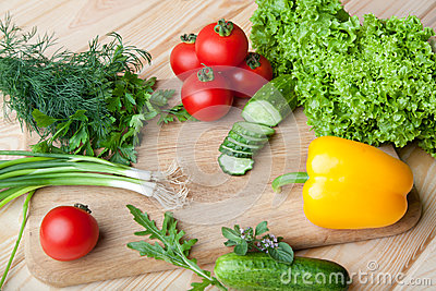 Fresh vegetables on cutting board.