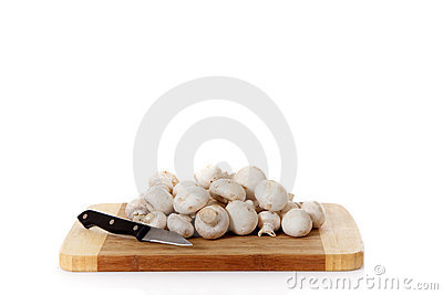 Fresh vegetables mushrooms, wooden chopping board.