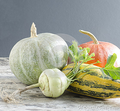 Fresh vegetables on old wooden table