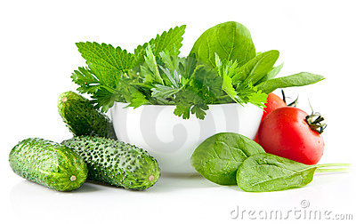 fresh vegetables with parsley and spinach in plate