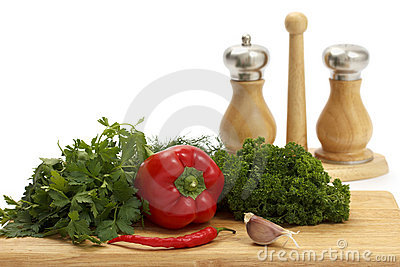 Fresh vegetables and spices on white background.