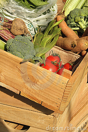 Fresh vegetables in a wooden box
