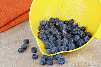 Fresh washed blueberries and strainer.