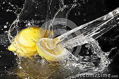 Fresh water drops on lemon on black